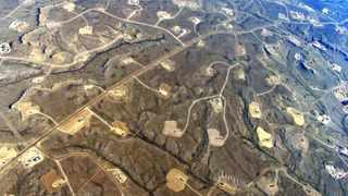 august 2014 pic credit: Photo courtesy of EcoFlight The dense field of natural gas wells in the Jonah Field in Wyoming, US, emphasises the potential for multiple, overlapping impacts of fracking on wildlife.