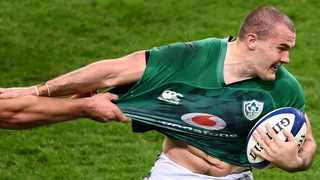 FILE - Ireland's Jacob Stockdale runs with the ball during the Six Nations rugby union match against France last year. Photo: Franck Fife/AFP