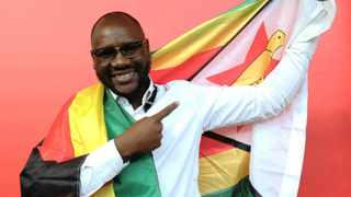 Pastor Evan Mawarire poses with a Zimbabwean flag wrapped around his body, in Harare. File picture: Tsvangirayi Mukwazhi