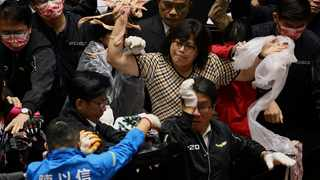 Taiwan lawmakers throw pork intestines at each other during a scuffle in the parliament in Taipei, Taiwan. Picture: Ann Wang/Reuters