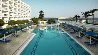 """Participants will have""""all-inclusive"""" access to the pool, restaurants and other facilities of the Mitsis Grand Hotel Beach, but nothing else. Picture: Mitsis Grand Hotel Beach."""