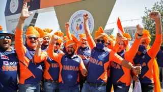 Fans wearing traditional headgear react as they wait to enter the newly named Narendra Modi Stadium, previously known as Motera Stadium, before the start of the second day's play in the third test match between India and England. Photo: Amit Dave/Reuters