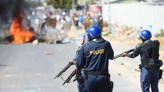 South Africa - Cape Town - 24 March 2021 - Police used rubber bullets and teargas in dispersing protesting residents of Kraaifontein,who are demanding water,electricity and toilets.The protesters are members of the Intlungu Yasematyotyombeni Movement that is on day 2 of the protest.They have burnt a City of Cape Town van and stoned passing cars this morning. Photograph : Phando Jikelo/African News Agency(ANA)