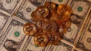 FILE PHOTO: Representations of virtual currency Bitcoin and U.S. dollar banknotes are seen in this picture illustration taken January 27, 2020. REUTERS/Dado Ruvic
