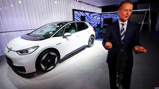 Volkswagen CEO Herbert Diess poses with the ID.3 electric car. File picture: Wolfgang Rattay / Reuters.