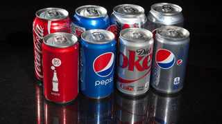 All the Covid-causing virus circulating in the world right now could easily fit inside a single cola can, according to a calculation by a British mathematician. Picture: Carlo Allegri/Reuters