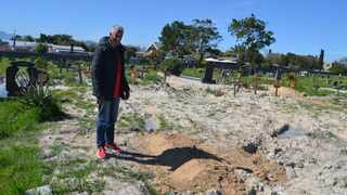Eugene Steenberg, 49, says the City of Cape Town flattened his daughter's grave in a Kraafontein cemetry when a tractor drove over it. Picture: Solly Lottering