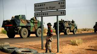 French armoured vehicles are seen heading towards the Niger border before making a left turn north in Gao, northern Mali.