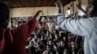 Some of the 200 Ethiopian nationals detained in Maula Prison for illegal immigration sit on the floor of the prison in Lilongwe, Malawi, on June 1, 2015. Picture: Mauricio Ferretti