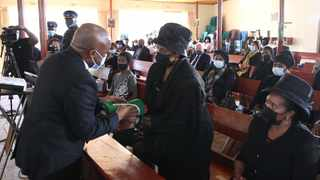 Premier Sihle Zikalala hands over the South African flag to Eunice Mdlalose at the funeral of her husband Dr Frank Mdlalose. Picture: Doctor Ngcobo/African News Agency (ANA)