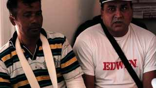 Indian migrant workers Nermal Chand, left and Vije Kumar who were attacked at their home by masked men near Athens, attend a news conference organized by anti-racism campaigners in Athens, Thursday, July 19, 2012. Human rights groups say racially motivated attacks have soared in Greece in recent months. The extreme right Golden Dawn party won 18 seats in parliament in elections last month. It denies direct involvement in the attacks. (AP Photo/Dimitri Messinis)