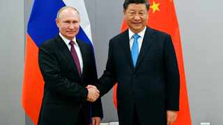 Russian President Vladimir Putin, left, and China's President Xi Jinping shake hands prior to their talks on the sideline of the 11th edition of the BRICS Summit, in Brasilia, Brazil, Wednesday, Nov. 13, 2019.The BRICS Summit, gathering the leaders of Brazil, Russia, India, China and South Africa, will take place in Brasilia Nov. 13-14. (Ramil Sitdikov, Sputnik, Kremlin Pool Photo via AP)