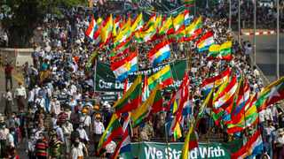 Supporters of Myanmar's military carry banners and flags during a rally in Yangon, Myanmar. File picture: Reuters/Stringer