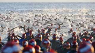 PORT ELIZABETH, SOUTH AFRICA - APRIL 10, swimmers during the Ironman South Africa competition at Hobie Beach on April 10, 2011 in Port Elizabeth, South Africa. Photo by Richard Huggard / Gallo Images