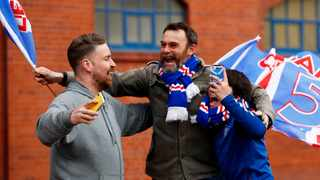 Rangers fans celebrate as they are confirmed as Scottish Premiership champions. Photo: Jason Cairnduff/Reuters