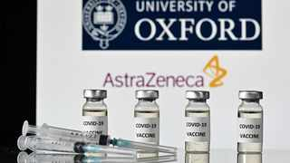 Vials with Covid-19 Vaccine stickers attached and syringes, with the logo of the University of Oxford and its partner British pharmaceutical company AstraZeneca. Photo by Justin Tallis/AFP