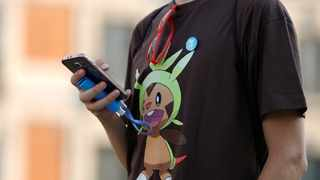 A young man plays the augmented reality mobile game Pokemon Go in Madrid, Spain. File picture: Reuters/Sergio Perez