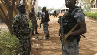 File picture: Malian soldiers stand in guard in Kati, outside Bamako.