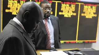 Stockbrokers work at the Zimbabwe Stock Exchange in Harare on Tuesday. Photo: Reuters