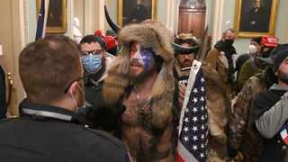 Supporters of US President Donald Trump, including member of the QAnon conspiracy group Jake A, aka Yellowstone Wolf (centre), enter the US Capitol on January 6 in Washington, DC. Photo: Saul LOEB / AFP