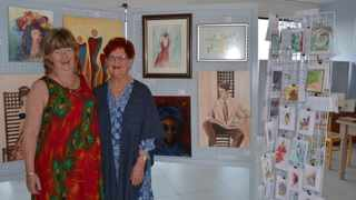 Brenda Pratt and her sister, gallery member Patricia McCann, with pieces curated for Women's Month.