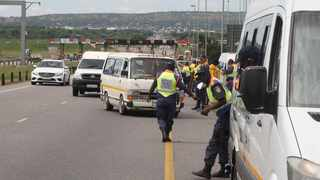Taxis are pulled over and checked during a roadblock on the N1 near the Pumulani Toll plaza. Picture: Jacques Naude/African News Agency (ANA)
