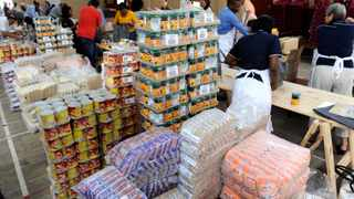 In this file picture, Brimstone Investment Corporation celebrates its 20th Anniversary that commenced with packing 1000 food hampers for distribution to people and communities in need. Picture Cindy Waxa.