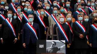 Richard Ferrand, speaker of French National Assembly, and members of parliament during a tribute to Samuel Paty, the French teacher who was beheaded on the streets of the Paris suburb of Conflans-Sainte-Honorine. Picture: Gonzalo Fuentes/Reuters