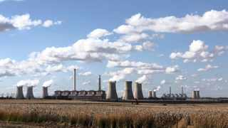 Steam rises from the cooling towers of the Matla power station, a coal-fired power plant in Mpumalanga. Picture: Reuters