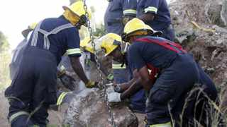 In this file, rescue officials remove a rock from an abandoned gold shaft as they work to rescue trapped illegal miners in Benoni. File picture: Mike Hutchings