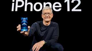 Apple CEO Tim Cook poses with the all-new iPhone 12 Pro at Apple Park in Cupertino, California, US. Picture: Brooks Kraft/Apple Inc./Handout via Reuters