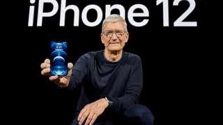 Apple CEO Tim Cook poses with the all-new iPhone 12 Pro at Apple Park in Cupertino, California, U.S. File picture: Brooks Kraft/Apple Inc./Handout via Reuters