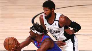Denver Nuggets forward Jerami Grant tussles with the Los Angeles Clippers' guard Paul George during their NBA clash. Picture: Kim Klement/Pool Photo via AP