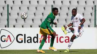 Musa Nyatama of Swallows FC is challenged by Ntsako Makhubela of Golden Arrows during their DStv Premiership clash at the Dobsonville Stadium in Soweto on Saturday. Photo: Muzi Ntombela/BackpagePix