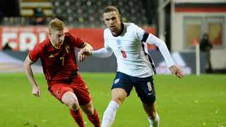 England's Jordan Henderson in action with Belgium's Kevin De Bruyne. Photo: Johanna Geron/Reuters