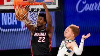 The Miami Heat's Jimmy Butler dunks the ball after getting past the Milwaukee Bucks' Donte DiVincenzo. Picture: Mark J. Terrill/AP