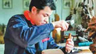 Feng Xiangbo carves using wood materials. Picture: Feng Xiangbo