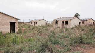 Houses which are part of the Woodlands low-cost housing project in the Msunduzi Municipality stand unfinished and have been stripped of materials, including roof tiles and doors. The project was stopped as the municipality allegedly failed to do an environmental impact assessment or lay down infrastructure for water and electricity before the houses were built. Picture: Thami Magubane