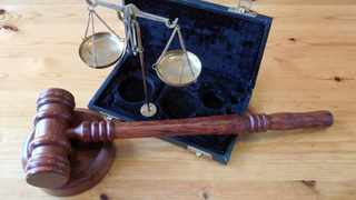 Illustration of a hammer used once a judge has reached a verdict in a case.