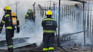 The City of Cape Town's Fire and Rescue Services seen extinguishing a house fire in Langa after it allegedly caught sparks from an unsupervised fire in front of the yard on the weekend. Picture: Sisonke Mlamla/Cape Argus
