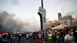 Demonstrators protest against the political elites and the government after this week's deadly explosion at Beirut port which devastated large parts of the capital and killed more than 150 people. Picture: Thibault Camus/AP