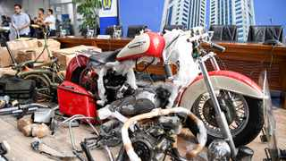 Evidences of Harley Davidson and Brompton bicycle, which were brought into Indonesia on a new Airbus plane of PT Garuda Indonesia, are pictured before a news conference at Indonesian Finance Ministry in Jakarta