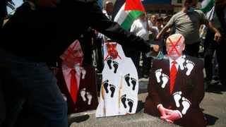 Palestinians burn pictures of US President Donald Trump, Abu Dhabi Crown Prince Mohammed bin Zayed al-Nahyan and and Israeli Prime Minister Benjamin Netanyahu during a protest against the United Arab Emirates' deal with Israel, in the West Bank city of Nablus. Picture: Majdi Mohammed/AP