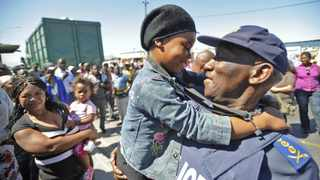 Cape Town - 111006 - Cele plays with 9 year old Busisiwe Soke - General Bheki Cele held a walkabout in Harare in Khayelitsha today. He greeted members of the community, listened to their problems and also examined an area where an alleged serial rapist lured his victims. - Photo: Matthew Jordaan