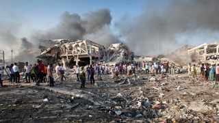 Somalis gather and search for survivors by destroyed buildings at the scene of a blast in the capital Mogadishu, Somalia. File picture: Farah Abdi Warsameh/AP