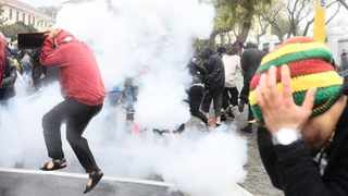 Anti-gender-based violence protesters try to escape smoke grenades set off by police at a recent protest in Cape Town. Picture: Phando Jikelo/African News Agency (ANA)