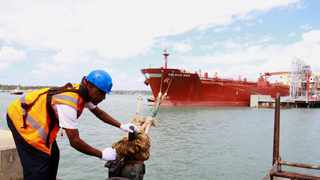 FILE PHOTO: Kenyan Ports Authority worker releases the oil tanker Celsius Riga to sail off with over 200,000 barrels of Kenya's first oil export, from the port of Mombasa