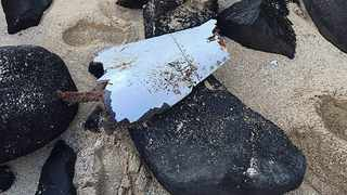 """This hand out picture released on May 27, 2016 by the Mauritius National Coastguard shows an aircraft debris, suspected to be part of the missing MH370 Malaysian airlines plane, found at the Gris Gris public beach near Souillac, in the southern part of Mauritius Island on May 24. The fate of the passenger jet, which is presumed to have crashed at sea after disappearing en route from Kuala Lumpur to Beijing with 239 passengers and crew on board in March 2014, remains a mystery. Five other fragments have previously been found and identified as definitely or probably from the Boeing 777. All of them were discovered thousands of kilometres (miles) from the current search zone far off Western Australia's coast. / AFP PHOTO / Mauritius National Coastguard / - / RESTRICTED TO EDITORIAL USE - MANDATORY CREDIT """"AFP PHOTO / Mauritius National Coastguard"""" - NO MARKETING NO ADVERTISING CAMPAIGNS - DISTRIBUTED AS A SERVICE TO CLIENTS"""