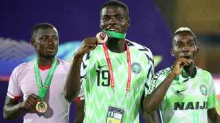 Nigeria's John Ogu with his bronze medal after winning the Third Place Play Off at last year's Africa Cup of Nations. Photo: Suhaib Salem/Reuters