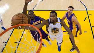 Golden State Warriors forward Kevin Durant (35) in action against Los Angeles Lakers forward Luol Deng (9, left). Photo: Kyle Terada/Reuters